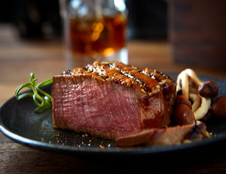 Grilled cut beef fillet with mushrooms and herbs