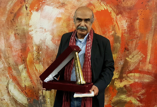 Bahraini poet Haddad holds the Cairo International Forum for Arabic Poetry prize in Egypt