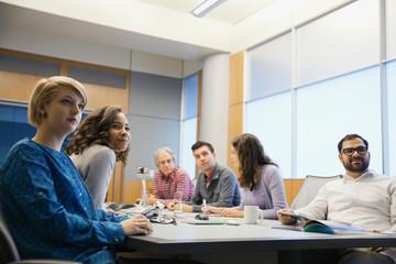 Business people looking away in board meeting