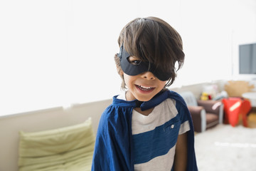 Portrait of boy wearing cape and mask