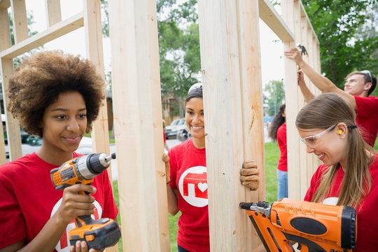 Volunteers assembling construction frame