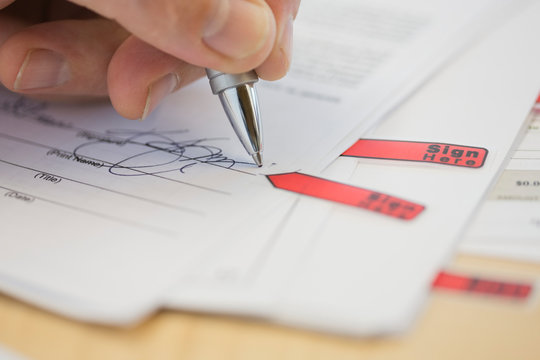 Close-up of businessman signing document