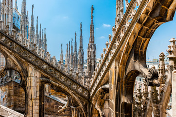 Foto op Plexiglas Milan The Ornate roof top of the Duomo in Milan, Italy