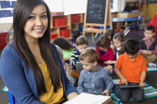 Portrait of confident teacher in elementary school