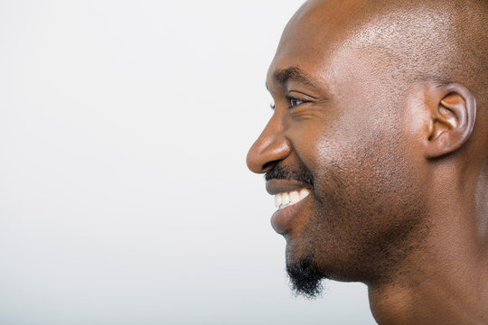 Close up profile of smiling man with goatee