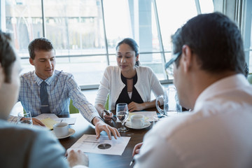 Business people discussing data in conference room meeting
