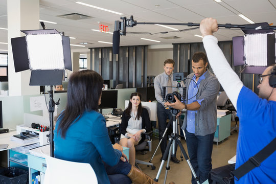 Business people filming in-house tutorial video