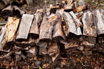 Photo sur Aluminium Texture de bois de chauffage Firewood for household needs in rural areas
