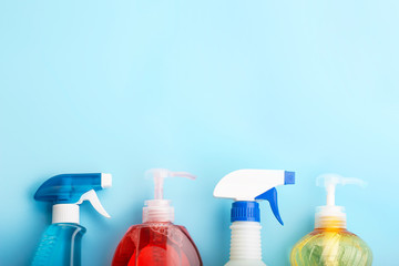 Cleaning products on blue background with copy space, spring cleaning concert