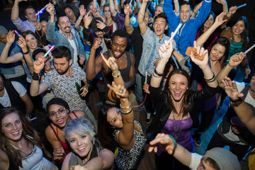 Portrait of cheering crowd on nightclub dance floor