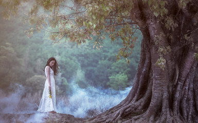 Woman with loneliness and sadness in the nature.