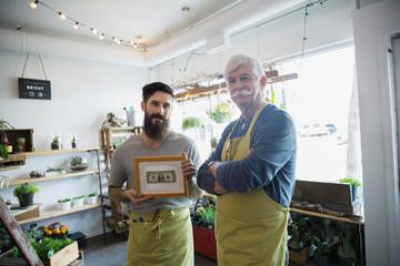 Portrait of terrarium shop owners showing first dollar