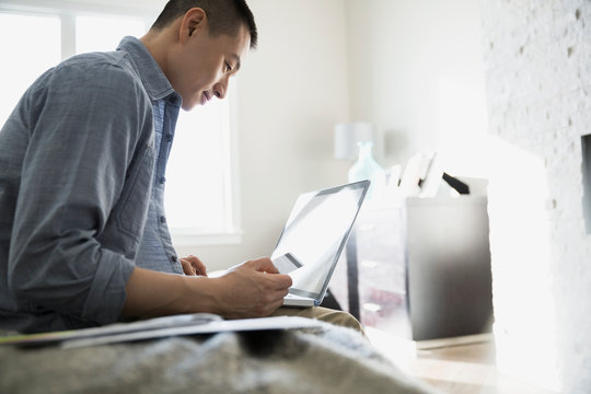 Man shopping online with credit card and laptop