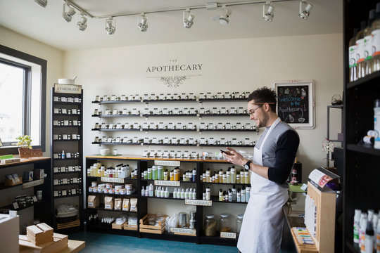 Apothecary shop owner texting
