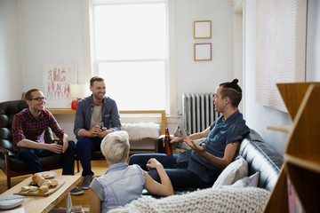 Homosexual and heterosexual couples hanging out living room