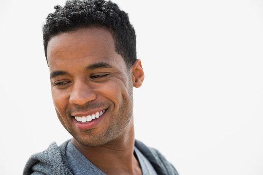 Portrait smiling man curly black hair looking down