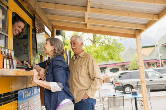 Older couple ordering at food truck