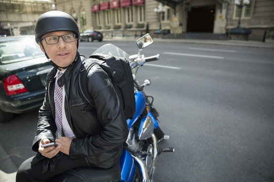 Businessman commuting on motorcycle