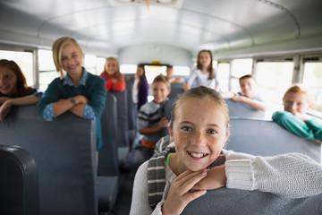 Portrait confident school kids on school bus