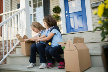 Girl scouts with cookies on front stoop