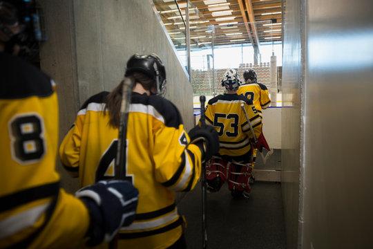 Womens ice hockey team heading toward ice rink