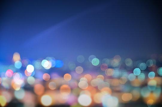 Colorful night city lights bokeh background,lights blurred bokeh background for your festival design backdrop