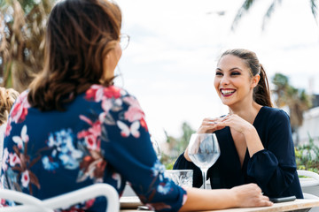 gay couple of girls on a date at an outdoor restaurant having fun