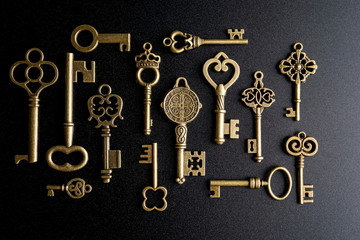 Bronze keys on black background antique key still life