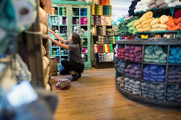 Woman shopping at yarn store