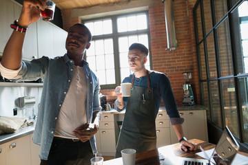 Entrepreneurial coffee roasters examining coffee in kitchen