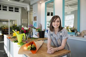 Portrait confident florist in flower shop