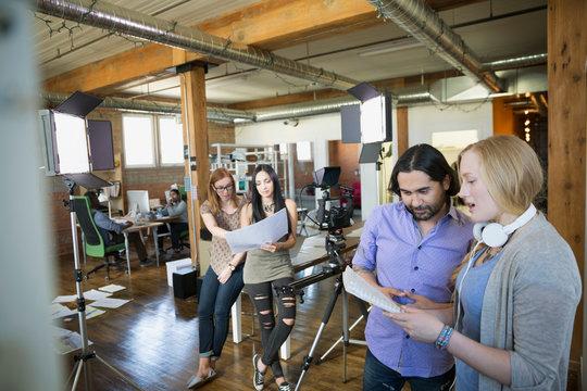Creative business people preparing to film tutorial