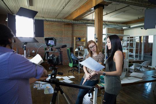 Creative business people preparing to film video tutorial