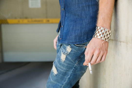 Close up young man smoking cigarette