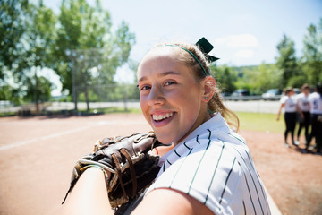 Portrait smiling middle school girl softball player