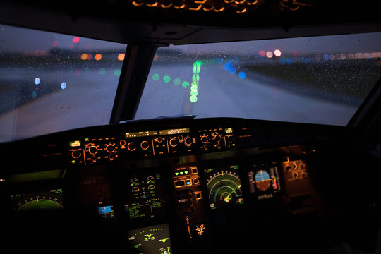 Modern cockpit a commercial airliner airplane during takeoff, taxing in an airport