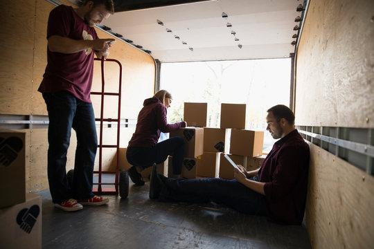 Volunteers inside truck with cardboard boxes
