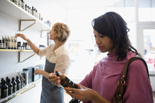 Woman shopping browsing beauty products in shop
