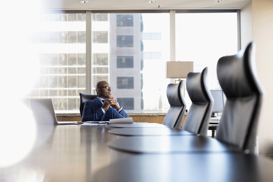 Pensive lawyer looking away in conference room
