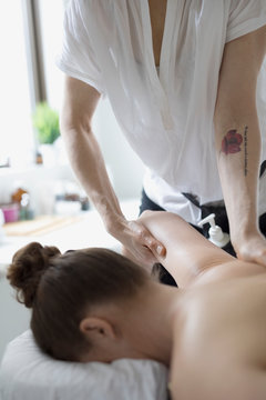Woman receiving massage on spa massage table