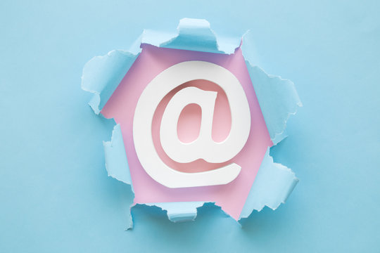 Burst hole email sign abstract on pastel background contact concept.