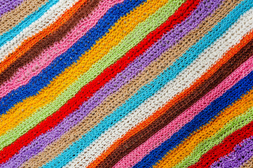 Knitting project over wooden background