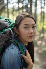 Portrait confident, serious teenage girl with backpack hiking