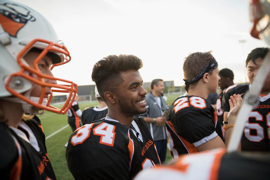 Teenage boy high school football team on football field