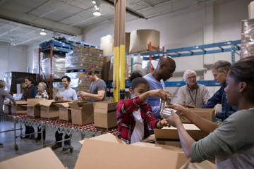 Volunteers filling boxes for Food drive in warehouse