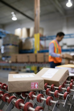 Packages on shipping warehouse production line conveyor belt