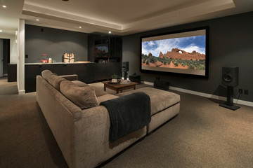 Movie playing on projection screen in home theater
