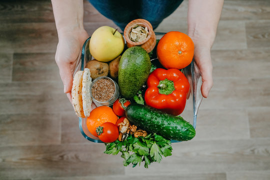 Functional foods, Health Super food concept very high in minerals, vitamins, antioxidants, omega 3. Various vegetables, fruits, nuts and seeds in woman hands