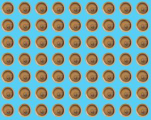Espresso coffee spot flat lay pattern on blue pastel color background. Pop art design concept.