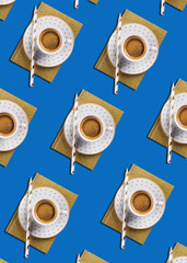 Cup of espresso coffee flat lay pattern with golden notebook diary on classic blue color background. Pop art design concept.